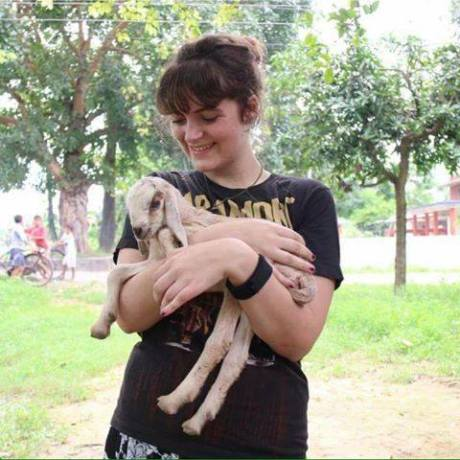 Francesca with the baby goat at her village placement